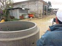 Poza Rica, Ver., 27 de marzo de 2015.- Las precipitaciones ocasionaron por vez primera encharcamientos en los interiores de viviendas de la colonia Palma Sola.