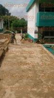 Papantla, Ver., 2 de septiembre de 2015.- Despu�s de la gran cantidad de lodo acumulada dentro del Colegio de Estudios se activ� el plan DN III, con el cual personal de la SEDENA comenz� con la limpieza de la instalaci�n.