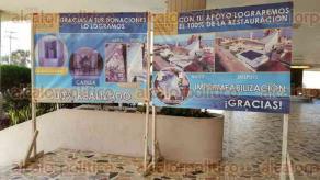 Coatzacoalcos, Ver., 12 de febrero de 2016.- En la entrada del Santuario de Guadalupe colocaron pancartas con im�genes y estad�sticas de avances en trabajos de remodelaci�n.