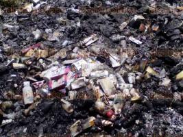 Banderilla, Ver., 28 de julio de 2016.- En la parte trasera del terreno de la Jurisdicci�n Sanitaria de este municipio, se capt� el momento en el que estaba inciner�ndose medicamento.