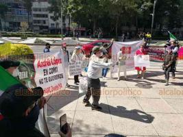 Ciudad de México, 8 de julio de 2020.- Integrantes del Frente Nacional Anti AMLO (FRENAAA) protestan frente a la embajada de EU. Acusan al Presidente López Obrador de buscar instaurar el socialismo, comunismo y ser una Venezuela con su dictador.