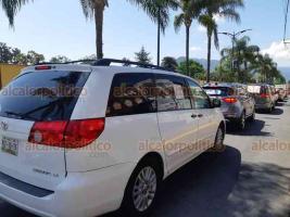 Orizaba, Ver., 12 de julio de 2020.- Ciudadanos salieron en sus automóviles en un recorrido por las calles de la ciudad, con el propósito de exigir la renuncia del presidente de la República, Andrés Manuel López Obrador.