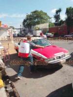Coatepec, Ver., 27 de julio de 2021.- Este martes, alrededor de 120 taxis de las bases Premier y Libres Unidos fueron desinfectados, esto en coordinación con autoridades de Transporte Público.